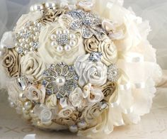Brooch Jeweled Bouquet in Champagne, Cream, Ivory with Brooches, Handmade Flowers, Lace, Satin Pearls and Jewels- Pamela. $450.00, via Etsy.