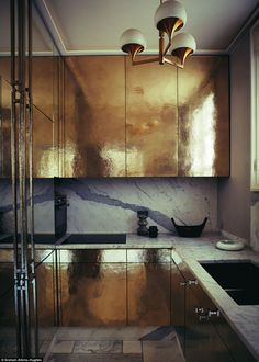 'The soft gold kitchen cabinets in Jean-Louis Deniot's Parisian pad (opposite) left me speechless. To master the metallic look, bear in mind that there is a fine line between adding pieces that instantly brighten a room and going overboard so that your space begins to feel like a nightclub,' says Ahern