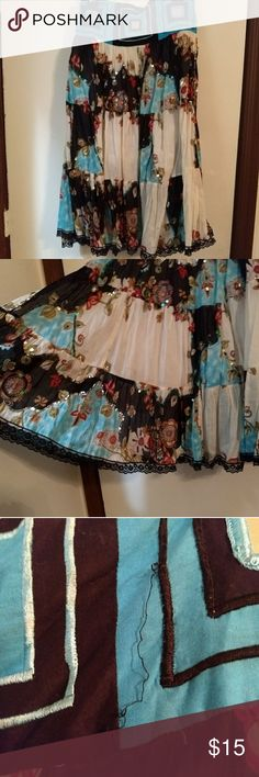 Light, mid-length flowy skirt (import-Spain) This gorgeous black, blue and white skirt was purchased in Menorca, Spain. Some stitching is coming loose and I don't know how to mend it. Mirror embellishments, lace trim, elastic back, thin knee length slip inside. Flower, sequins, and patch design. Marked size s/m but stretches. Skirts