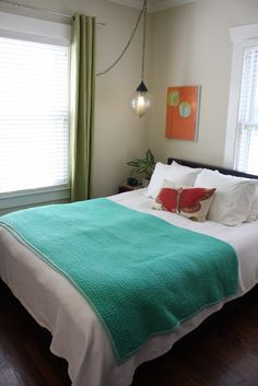 teal blanket orange print green curtains