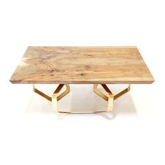 """The """"Trinket"""" Coffee Table is an original design from David Nashif.  It's flowing design of interlocked hexagon ribbons is finished in a rich, yet subtle polished bronze plating. The table top is fabricated from a stunning pair of bookmatched Clar..."""