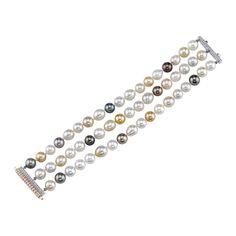 South Sea Pearl Three Strand Diamond Gold Bracelet | From a unique collection of vintage modern bracelets at https://www.1stdibs.com/jewelry/bracelets/modern-bracelets/