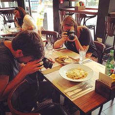 Two Trufflers Nick and Lizzie taking their #foodphotography very seriously before consuming EVERYTHING.