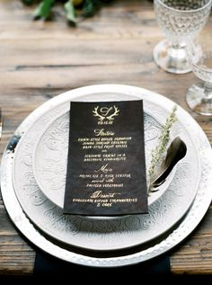 Elegant black and gold wedding table decor: http://www.stylemepretty.com/montana-weddings/columbia-falls/2016/03/03/rustic-intimate-northwest-montana-wedding/ | Photography: Jeremiah and Rachel - http://jeremiahandrachel.com/