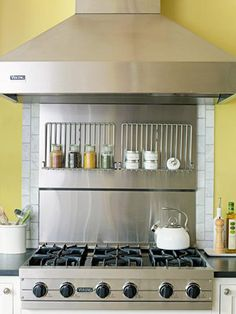 Fold-down wire racks mounted on a stainless steel backsplash can be used for storage or to support serving dishes.