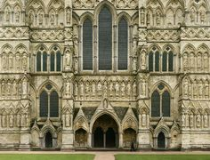 Salisbury Cathedral. A solitary figure walks in front of the South Front of Salisbury Cathedral, seemingly oblivious to the dozens of silent stone spectators, some of which are nearly 800 years old. - Photo by Max Lyons