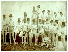 The Brighton Swimming Club poses in their top hats before going for a swim in 1863.
