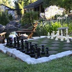 """Patio tiles turned game board just beg you to let the good times roll. Whether the attraction is a simple game of chalk-drawn hopscotch or a chess match played with life-size pawns, you'll always be able to say """"game on"""" at your place."""