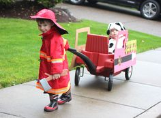 """Halloween: Fireman and dalmatian in his red """"fire engine"""" (decorated Radio Flyer wagon). So cute!"""