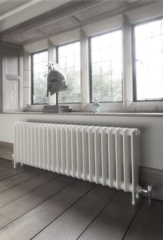 School style cast iron radiator reclaimed and refurbished by Ribble Radiators.   Painted in Buttermilk