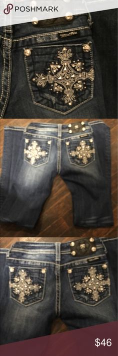 Miss Me Faded & distress boot cut jeans These have been gently worn have distress on bottom of jeans as in picture . And distress look across back band and around pockets .waist measures 131/4 inches . Mid rise seam is 7 inches . Inseam  31 inches .rhinestone and embroidered on back pocket . Has black miss me label . Miss Me Bottoms Jeans