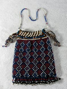 Beaded tobacco bag from the Xhosa people of South Africa. Early 1900's. British Museum collection.