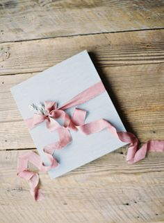 an album wrapped in ribbon