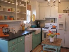 Cute kitchen for a small cottage.  I could see my daughter having a kitchen like this.  Love the use of color here!