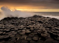Giant's Causeway, Ireland  The Giant's Causeway is a magnificent basalt rock formation located on Ireland's northeast coast. The tops of the incredible hexagonal basalt columns form stepping stones to the ocean. The nearest town to the Giant's Causeway is the tiny community of Bushmills, only 3km (2 miles) north. The slightly larger towns of Ballycastle and Coleraine are also nearby. Belfast, the largest city and capital of Northern Ireland, is 95km (59 miles) to the south.