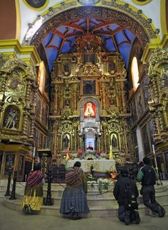 Devout pilgrims pray at the Virgin of Copacabana sanctuary, in the Titicaca Lake, Bolivia, near the border with Peru on April 5, 2012, after walking 140 km from La Paz during Holy Week celebrations.