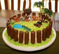 Zoo birthday party cake, twix zoo bars, plastic animals, coconut grass, cute game ideas too. http://www.birthdaypartyideas4kids.com/zoo-birthday-theme.htm#.UZQAaaJOOSo
