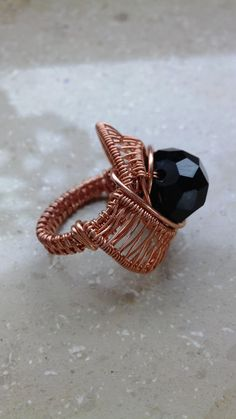I wrapped this beautiful chunky ring with copper wire and included a large black Czech glass bead. This piece looks beautiful on the finger, guaranteed to