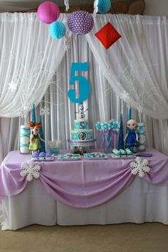 Frozen Birthday Party dessert table and backdrop! See more party planning ideas at CatchMyParty.com!