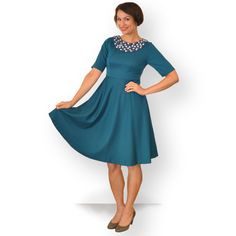 Teal full skirt dress with featured covered button neckline. $179.00, via Etsy.