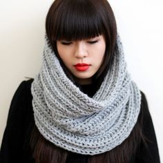 love the round and round scarf, the bangs, the red lipstick - lovely!