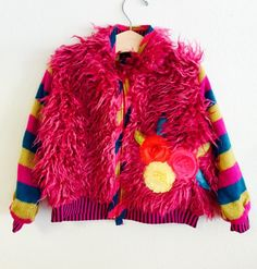 3c78a3b0b42 Your little fashionista will fall in love with this adorable multi-colored  fuzzy jacket from Zaza Couture.