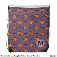 Kawaii Halloween Pumpkin Pattern Drawstring Bag by NamiBear on Zazzle.com. This is a pattern of a smiling carved pumpkin with bats. The color of orange, purple, and black  adds to the feeling of fall and Halloween. The background has a texture that gives a bit of a grunge look. Your initial can be printed on this design.