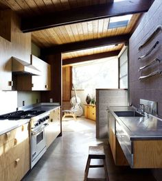 Concrete floor, wood cabinets, stainless steel countertops. Perfect combo.