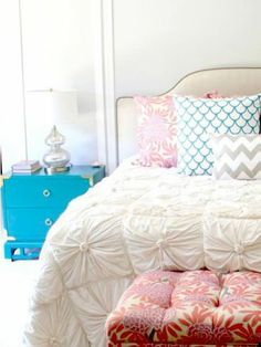 White bedroom with pops of color, pattern and texture.