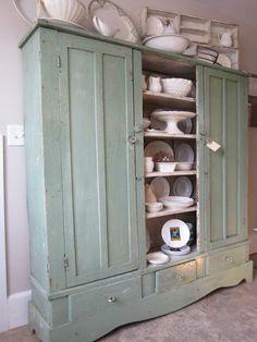 I need more storage in my kitchen...what better than this gorgeous antique cupboard...