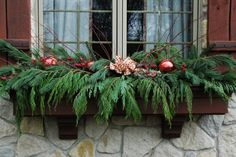 Great windowbox design - fresh cut evergreens and branches