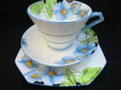 Iceland poppies grace this lovely Paragon China tea trio. This is a reproduction of china made for Queen Mary.