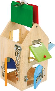 This wooden House Of Locks comes complete with many different locks, levers, and a door chain. This house trains everyday fine motor skills. Activity Toys, Activity Centers, Activities, Games For Kids, Diy For Kids, Baby Toys, Kids Toys, Baby Baby, Escape Box