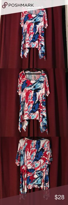 ❤️️abstract floral sharkbite top plus size ❤️️ The avenue muti color abstract flowers 🌺 shark bite bottom longer on the sides app 29inches long in the center 🎈sides app 32inches 95 rayon 5 spandex very attractive  💞boat neckline plus size knit top 🎈🎈🎈this is a firm price I already have it at the lowest I can do thank you for stopping bye 🎈🎈🎈 Avenue Tops Tees - Short Sleeve