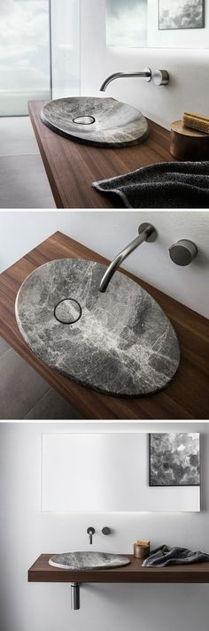 The design of this natural stone sink is inspired by the shape of craters left from a volcano This modern bathroom sink made from natural stone sits on a floating wood vanity and has a simple stainless steel faucet. Modern Bathroom Sink, Bathroom Faucets, Bathroom Interior, Modern Sink, Vanity Bathroom, Modern Bathrooms, Simple Bathroom, Dream Bathrooms, Vanity Faucets