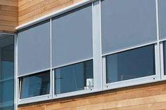 Grijze windvaste screens - strakke en moderne buitenzonwering