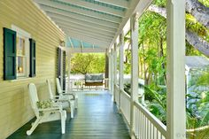 Porch sitting can easily become an everyday pastime at Belle Maison Du Port Pergola On The Roof, Pergola Ideas For Patio, Pergola Swing, Cheap Pergola, Covered Pergola, Porch Swing, Pergola Cover, Victorian Cottage, Victorian Homes