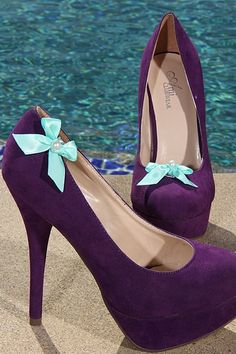 Purple heels with blue bow... I love the idea of having the bows in different places on each shoe