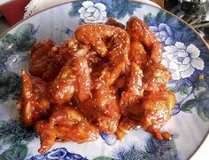 Sprinkle chicken wings with salt, pepper and garlic powder. Set aside for 15-30 minutes.  Mix the following together: 1 cup of ketchup, hot pepper paste, corn syrup, soy sauce and lemon juice. Set as