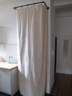 Curtain to hide eyesores: mop, broom, etc