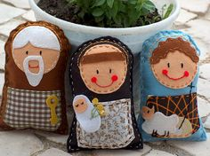 Made with felt and running stitches.  Very Cute.  Up close this could be Joseph, Mary, Baby Jesus, and a Wiseman.