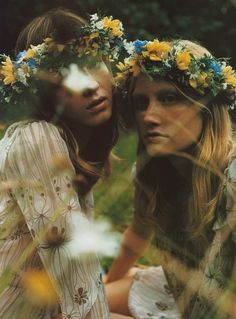 Two girls wearing yellow and green flower crowns