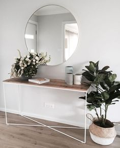 Use a narrow console table as a landing strip for keys and decor accents.