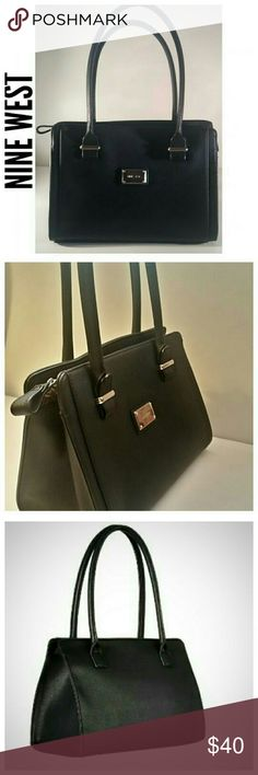 """Nine West Metro Girl Satchel This large black satchel features a classic crosshatch design accented with silver metal details,  2 rolled handles, zipper closure, and a fun printed lining with ample storage. Imported.   **Excellent condition. Never been used. New w/out tags.**  Bag Measures: 13.25"""" wide x 5.5"""" deep x 9.25"""" high. Strap drop: 9.25 inches---Strap length: 27""""   Material: Crosshatch PVC/Polyester Nine West Bags"""