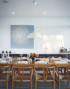 ontario vacation home with cloud white dining area with custom table and carl hansen & søn pendant lamp