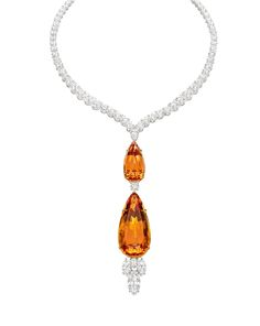 """""""The rich golden hue of November's gemstone, Topaz, coupled with the world's most magnificent diamonds."""""""