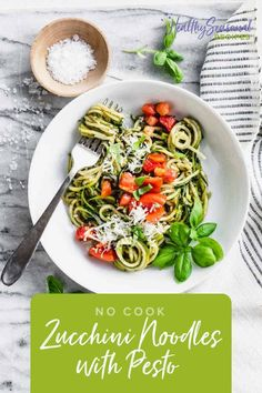 Zucchini Noodles with Pesto and Tomatoes is a healthy no-cook vegetarian dinner for hot summer nights. #nocookrecipes #zucchininoodles #pesto
