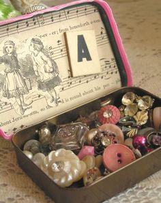 button tin  It was commonplace for mothers and grandmothers to have these small tins filled with buttons, etc.