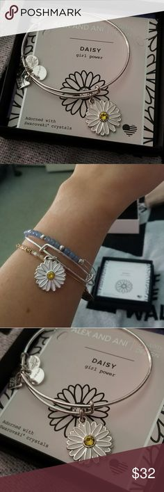 Alex & Ani Daisy bracelet Alex & Ani Charity by Design daisy bracelet. Shiny silver finish with enamel and yellow cz.   Such a cute bracelet! Brand new. Perfect condition. Includes card and box. Alex & Ani Jewelry Bracelets
