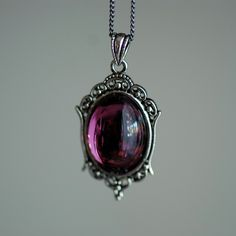 It's named after me!! I must have one! Katherine Necklace - VIctorian Goth Swarovski Amethyst Crystal Cabochon. $22.00, via Etsy.